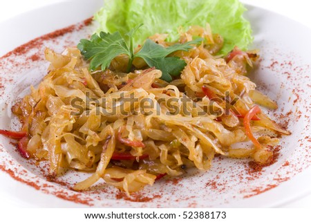 stewed cabbage on white plate. close up - stock photo