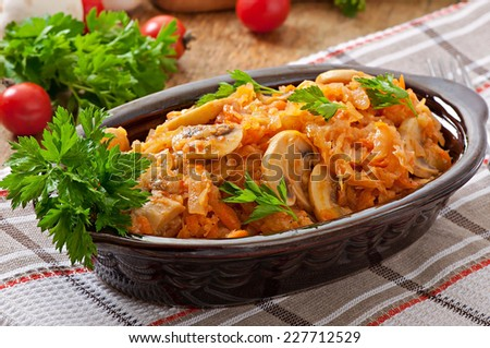 Stewed  cabbage with mushrooms and tomato sauce - stock photo