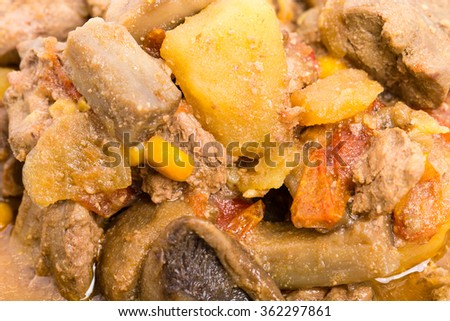 Stewed chicken liver with mushrooms and potatoes closeup. Macro. Photo can be used as a whole background.