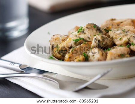 Stewed chicken with herbs on the plate,shallow focus - stock photo
