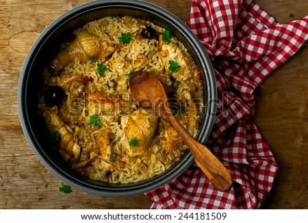 Stewed chicken with rice and dates in the crock-pot.selective focus - stock photo