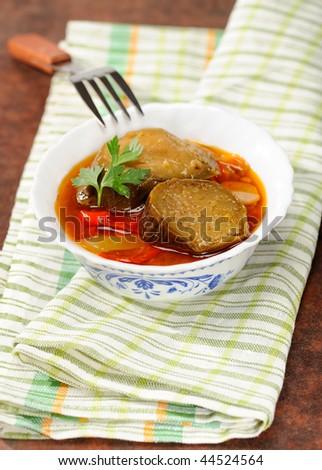 Stewed eggplants with vegetables - stock photo