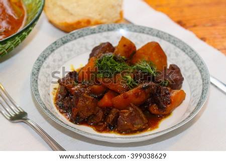 stewed lamb with potatoes, prunes, onions, garlic, dried tomatoes, a barberry and spices in red wine