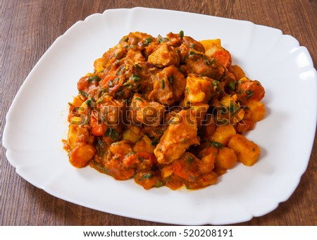 Stewed meat with vegetables in a plate