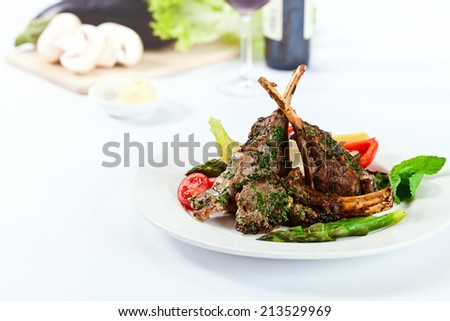 Stewed mutton with grilled vegetables on a white plate