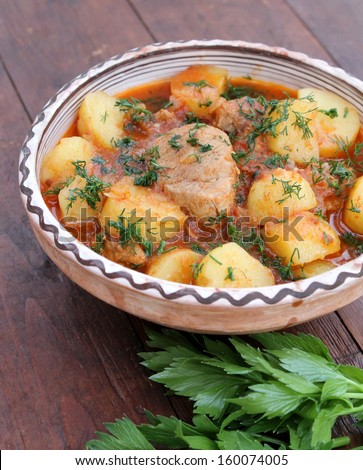 Stewed potatoes with meat - stock photo