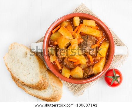 Stewed potatoes with meat, carrots and tomatoes - stock photo