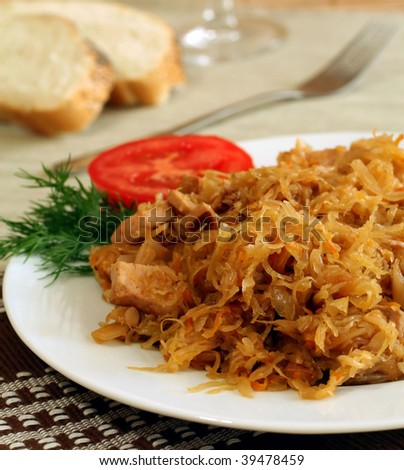 Stewed sauerkraut with sausage on a plate - stock photo