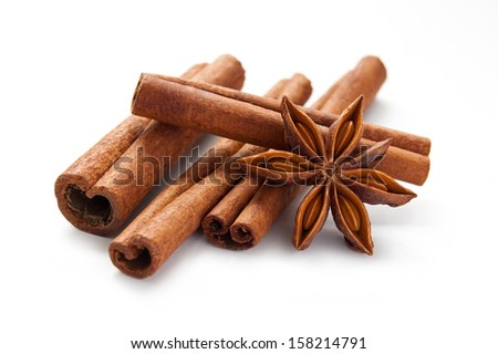 Stick cinnamon and star anise on the white background - stock photo