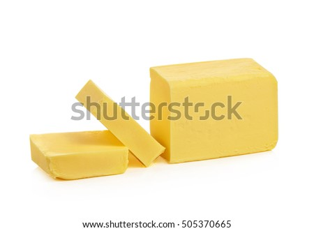 Stick of butter cut isolated on white