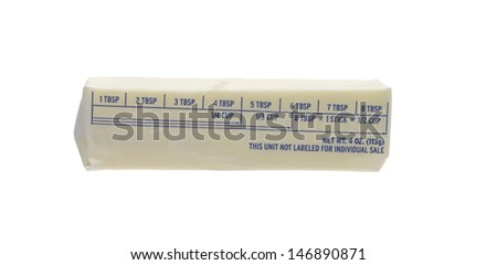 Stick of wrapped sweet cream butter quarter isolated on white, - stock photo