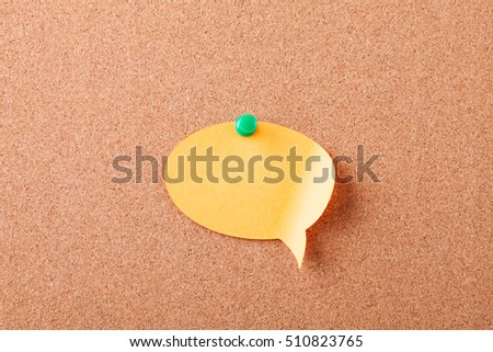 Sticker button pinned on a cork board