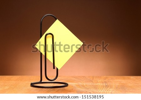 Sticker holder on the wooden table - stock photo