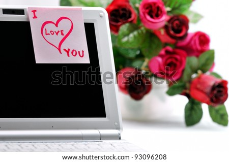 """Sticker """"I Love You"""" on a laptop and a bunch of flowers. - stock photo"""