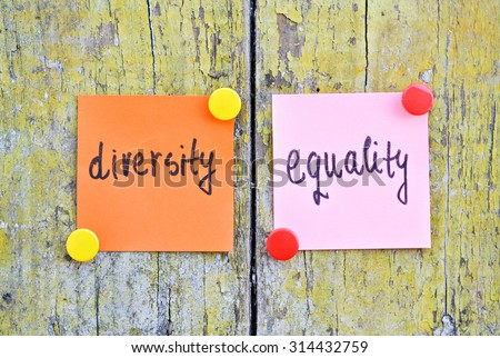 Stickers with words Diversity and Equality on wooden background - stock photo