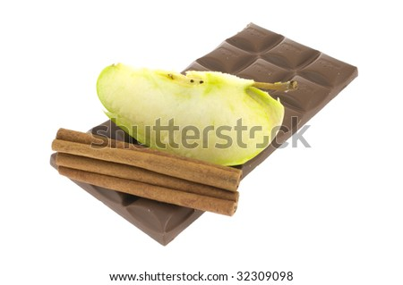 Sticks cinnamon with a bar of chocolate and an apple isolated on a white background
