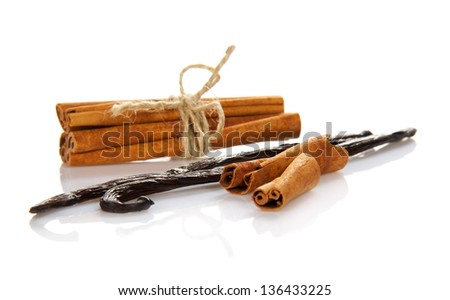 Sticks of cinnamon and the pods of vanilla isolated on white - stock photo