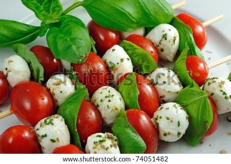 Sticks with tomato, mozzarella and basil - spiced - stock photo
