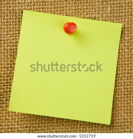 Sticky note attached to bulletinboard - stock photo