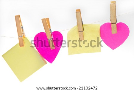 Sticky note hanging on line isolated on white - stock photo