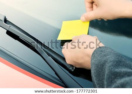 Sticky note on a windshield - stock photo