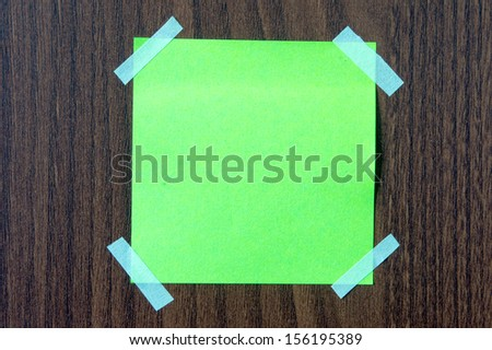 Sticky note on the brown wall