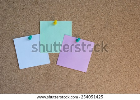 sticky note pinned on a cork board