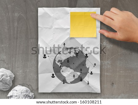 sticky note social network icon on crumpled paper background as concept - stock photo