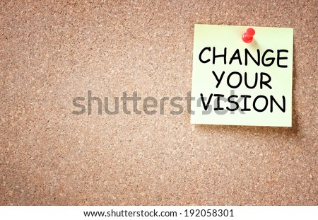 sticky note with the phrase change your vision, room for text - stock photo