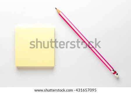 Sticky note,Yellow notepad and pencil on white background - stock photo