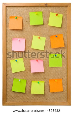 Sticky notes attached to a noticeboard - stock photo