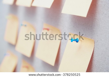 Sticky notes on a bulletin board. Close-up view - stock photo