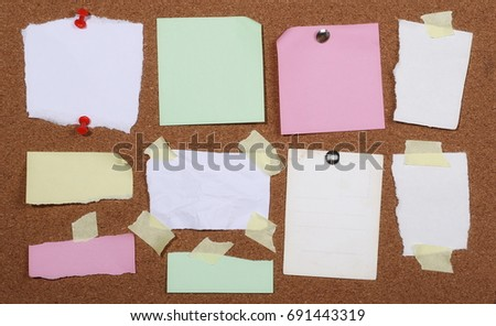 Sticky notes pinned on cork bulletin board background and texture