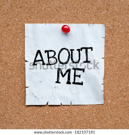 Sticky pinned to corkboard with the phrase about me . room for text. - stock photo