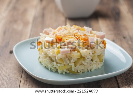 Sticky rice with carrots, zucchini cooked ham and melted cheese