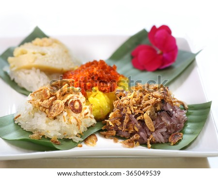 Sticky rice  with steamed egg custard and minced coconut, shrimp, sweet coconut topping /Thai dessert - stock photo