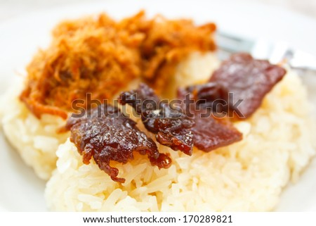 Sticky rice with sweet pork chop and fried meat, Thailand. - stock photo