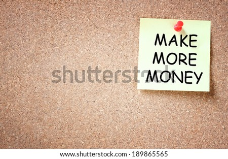 sticky with the phrase make more money written on it. room for text. - stock photo