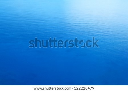 Still blue sea water surface as background - stock photo