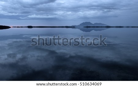 Still dark cloudy northern seascape after sunset
