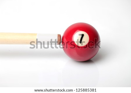 Still image of a pool cue resting on a number seven - stock photo