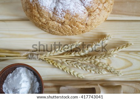 Still life. a loaf of bread, wheat flour and wheat spikelets. baking bread, village bakery - stock photo