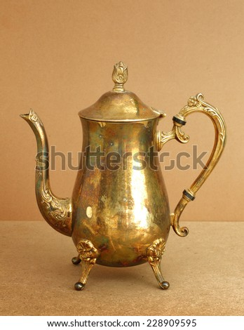 Still life art photography on Arab brass jar on clear background
