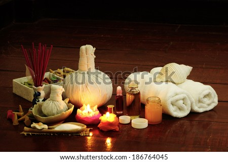Still life art photography on spa concept with oil treatment herbal massage balls exfoliation salt scrub and spa accessories - stock photo