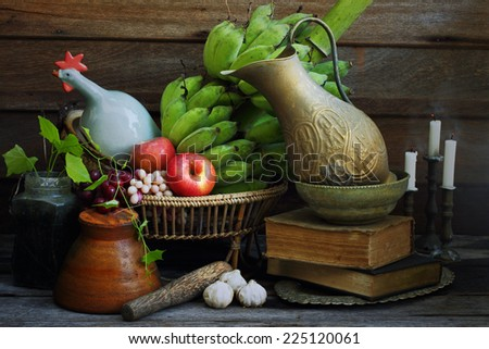 Still life art photography two light sources on fruits with Arab jar candles and mortar - stock photo
