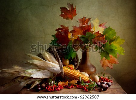 Still Life Autumn concept image with chestnuts corn and maple leafs