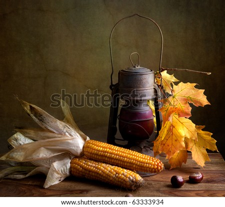 Still Life Autumn concept image with vegetables and old lamp