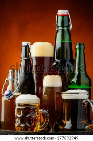 still life background with different bottles of beer - stock photo