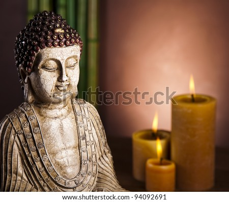 Still life, Buddha with candle - stock photo