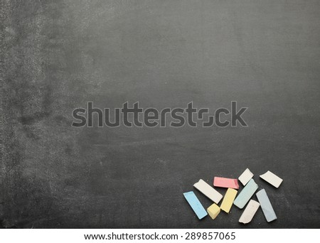 Still life, business, education concept. Black dusty chalkboard with chalks. Selective focus, copy space background, top view - stock photo